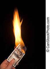 Burning 100 Dollar Bill - A one hundred dollar bill on...