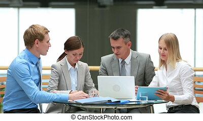 Office discussion - Group of business people gathered for a...