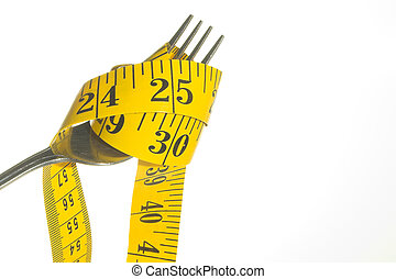 Weight Loss Concept - A tailor\\\'s tape pouring into a...