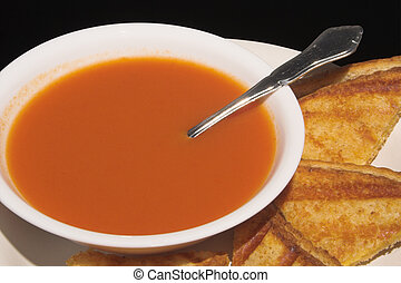 Soup and Sandwich - A grilled cheese sandwich and a bowl of...