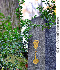 Tombstone with golden chalice