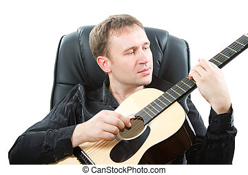 Musical instrument. Guitarist playing acoustic six-string...