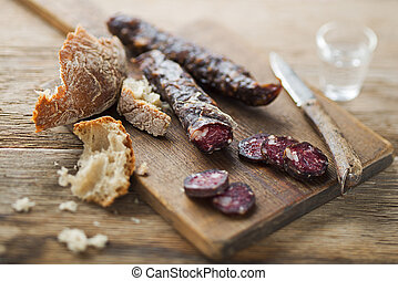 Salami - Tasty salami sliced with bread close up shoot