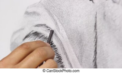 charcoal drawing close up - artist a work on charcoal sketch...