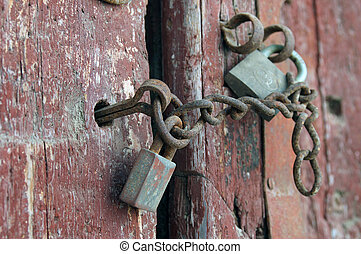 Old door - Gates old house with a padlock