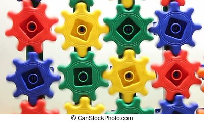 interlocking gears - colorful plastic gears turning on a...
