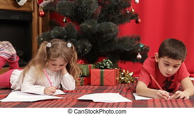 A letter to Santa - Brother and sister writing a letter to...