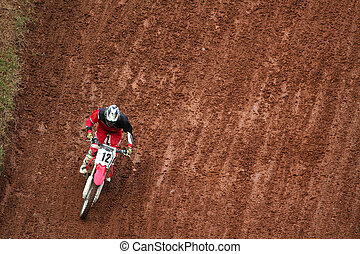 Man on motocross - Man on a moto after a curve in downhill