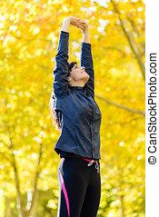 Woman in shape exercising outside - Beautiful brunette sport...