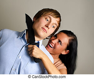Woman is trying to kill man by knife