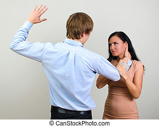 Man slapping a woman depicting domestic violence