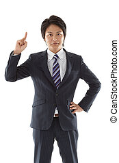 Young businessman pointing upward
