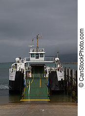 Empty ferry boat on slipway prior to loading