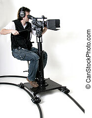 hd-camcorder on the dolly - cameraman work with...