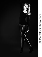 slinky - Full length portrait of an attractive young woman...