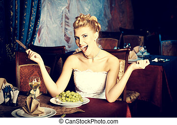 hungry bride - Beautiful bride in a luxurious restaurant....
