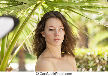 woman  on a background of palm trees