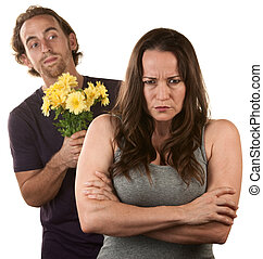 Angry Woman and Man with Flowers - Angry young woman and man...