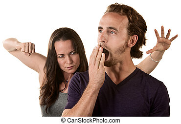 Woman Ready to Punch Yawning Man - Woman winding up to punch...