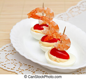 Canape with egg and a shrimp