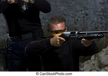 Men shooting on an outdoor shooting range - Men shooting on...