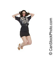 pretty brunette woman wearing casual New York tshirt jumping...