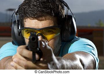 Man shooting on an outdoor shooting range - Man shooting on...