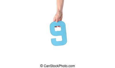 Female hands holding COUNTDOWN - Cardboard cutout with the...