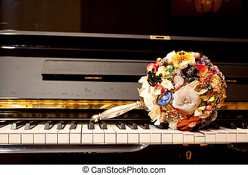 Brooch Bouquet on Piano - A bride's brooch bouquet sets on...