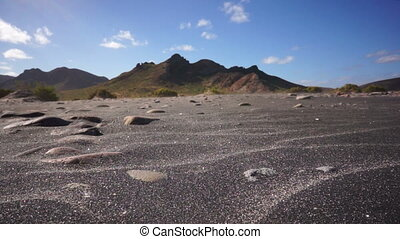 Black Sand Wind Erosion - Very low perspective shot of black...