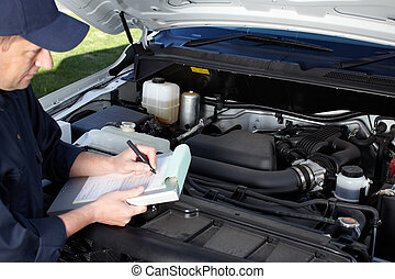 Car mechanic working in auto repair service. - Professional...