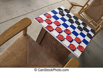 Checkers Game - A checkers board set up and ready to play.
