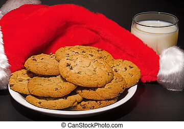 Santa\\\'s Milk And Cookies - A plate of cookies and a glass...