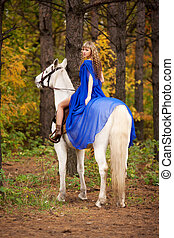 in the autumn park 8 - Young girl riding a white horse in...