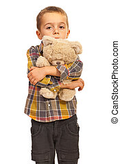 Sad kid hugging teddy - Sad kid boy hugging teddy bear and...