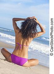 Sexy Woman Girl Sitting Bikini on Beach - A sexy young...