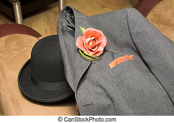 Mens Jacket with Rose and hat at a wedding