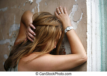 Despair - The girl with long hair at an old wall