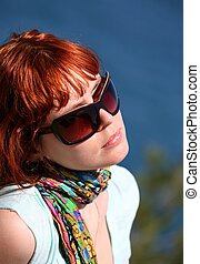 Solar procedures - The woman with red hair enjoys the sun