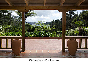 Tropical patio - A sub tropical wooden patio near bush and...