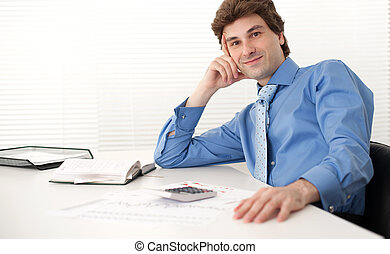 portrait of a businessman sitting in his office