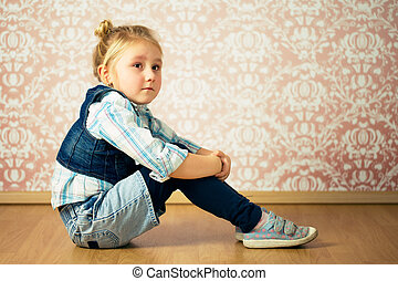 beautiful little girl sitting on floor