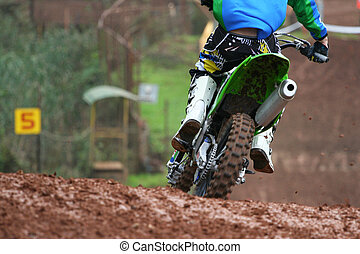 Man on motocross - Back of a motocross before a downhill.