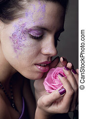 Girl smelling rose - Beautiful young brunette woman closing...
