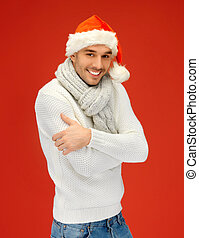 handsome man in christmas hat - bright picture of handsome...