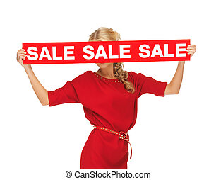 lovely woman in red dress with sale sign - picture of lovely...