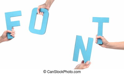 Female hands holding FONT - Cardboard cutout with the word...