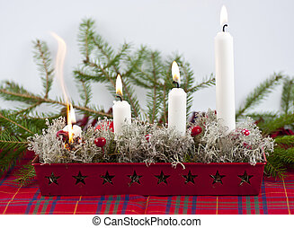 Candles setting fire - Burning candles in a advent candle...