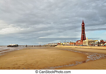 Blackpool Tower and pier, viewed across the sands. - A view...