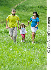 In the park - Photo of happy people outdoors holding each...